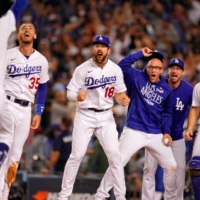 OCT 6, 2021; LOS ANGELES, CALIFORNIA, USA; THE LOS ANGELES DODGERS CELEBRATE THE WALK-OFF TWO RUN HOME RUN HIT BY LEFT FIELDER CHRIS TAYLOR (3) AGAINST THE ST. LOUIS CARDINALS DURING THE NINTH INNING AT DODGER STADIUM. THE LOS ANGELES DODGERS WON 3-1. MANDATORY CREDIT: ROBERT HANASHIRO-USA TODAY SPORTS