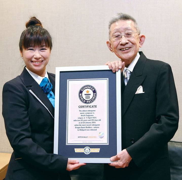 Koichi Sugiyama (right) is recognized by Guinness World Records in September 2016 as the oldest person to compose music for a video game. | COURTESY OF SQUARE ENIX CO. / VIA KYODO