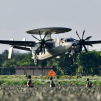 A U.S.-made E2K early warning aircraft takes off from a motorway in Pingtung, Taiwan, during the annual Han Kuang drill on Sept. 15. | AFP-JIJI