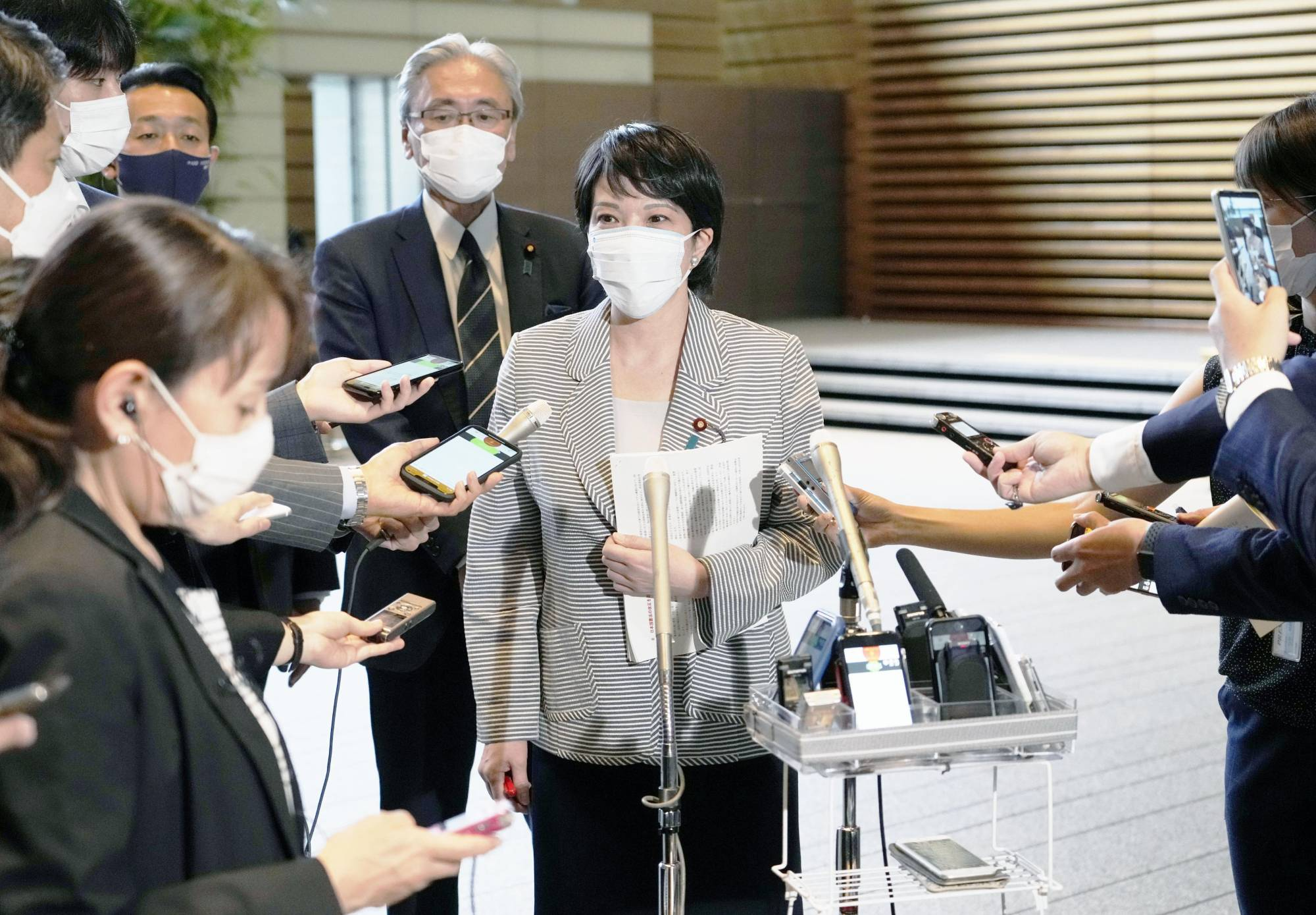 The Liberal Democratic Party's policy chief, Sanae Takaichi, answers questions about the party's election platform at the Prime Minister's Office on Thursday.   KYODO
