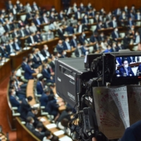 A television camera shows Fumio Kishida during a Lower House plenary session in Tokyo on Monday. | AFP-JIJI