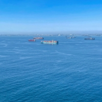 Container ships wait off the coast of the congested Ports of Los Angeles and Long Beach in California on Oct. 1. | REUTERS