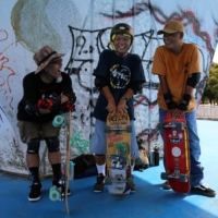 Yoshio Kinoshita (center) says he recommends skateboarding as a way to keep dementia at bay.   REUTERS