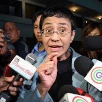 Philippine journalist Maria Ressa speaks to the media as she arrives at the National Bureau of Investigation headquarters after her arrest in Manila in February 2019.  | AFP-JIJI