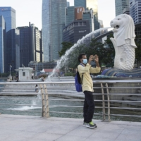 The Marina Bay area of Singapore. Daily infection levels have been ticking higher since the Singaporean government signaled a shift in its COVID-19 strategy, from wiping out all cases to accepting the virus is endemic.  | BLOOMBERG