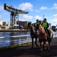 Mounted officers patrol near the SSE Hydro venue in Glasgow, Scotland on October 4, 2021 as the city prepares to host the COP26 UN Climate Summit. World leaders are under unprecedented pressure to decarbonize their economies and chart humanity's path away from catastrophic global warming.   AFP