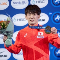 Japan's Ken Matsui celebrates on the podium in Oslo on Friday.  | NTB / VIA REUTERS