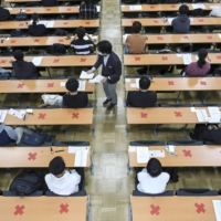 Candidates attend the annual unified college entrance examinations at the University of Tokyo in January.   KYODO
