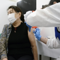 A woman gets a COVID-19 shot in Nagoya on April 14.   KYODO