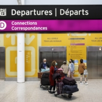 Travelers with luggage carts at Toronto's Pearson International Airport on Wednesday   BLOOMBERG
