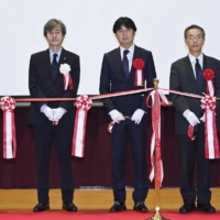 Hironori Fudeyasu (center), head of the Typhoon Science and Technology Research Center, and others attend the center's opening ceremony in Yokohama on Oct. 1. | KYODO