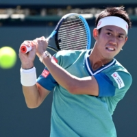 Kei Nishikori hits a shot during his BNP Paribas Open second-round match against Daniel Evans on Saturday in Indian Wells, California.   USA TODAY / VIA REUTERS
