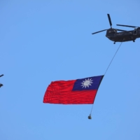 A CH-47SD helicopter carrying the Taiwanese flag takes part in a National Day celebration in Taipei on Sunday.   BLOOMBERG