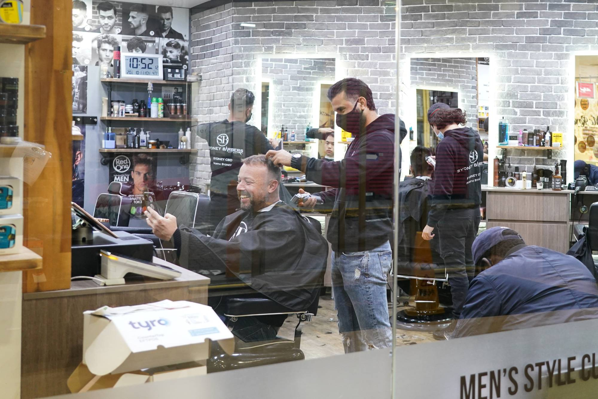 A city center barber shop in Sydney on Monday  | REUTERS