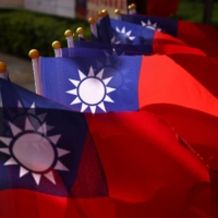 Taiwanese flags are seen at a square ahead of National Day celebrations in Taoyuan, Taiwan, on Friday. | REUTERS