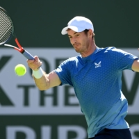 Andy Murray hits a shot against Carlos Alcaraz during their second-round match at the BNP Paribas Open in Indian Wells, California, on Sunday.   USA TODAY / VIA REUTERS