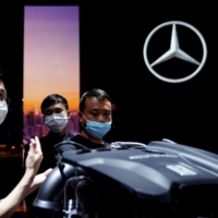 The Mercedes-Benz booth at the Auto Shanghai show in April    REUTERS