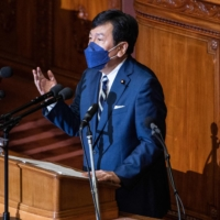 Yukio Edano, leader of the main opposition Constitutional Democratic Party of Japan, speaks druring a question and answer session with Prime Minister Fumio Kishida at the Lower House in Tokyo on Monday. | AFP-JIJI