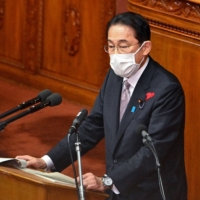 Prime Minister Fumio Kishida speaks during a question and answer session at the Lower House in Tokyo on Monday. | AFP-JIJI