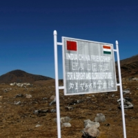 A signboard is seen from the Indian side of the India-China border at Bumla, in the northeastern Indian state of Arunachal Pradesh, in November 2009.   REUTERS