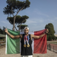Lamont Marcell Jacobs, who won Olympic gold for Italy in the 100-meter dash and 400-meter relay, with his medals in Rome.  | NADIA SHIRA COHEN / THE NEW YORK TIMES