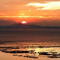 The sun sets over China's southeastern coast of Fujian province as seen from Taiwan's front-line island of Kinmen in September 2004.  | REUTERS