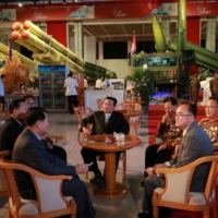 North Korean leader Kim Jong Un attends the 'Defense Development Exhibition' in Pyongyang in this undated photo released Tuesday.    KCNA / VIA REUTERS