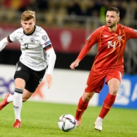Germany forward Timo Werner controls the ball next to North Macedonia defender Darko Velkovski during their match at Toshe Proeski National Arena in Skopje, North Macedonia, on Monday.   AFP-JIJI