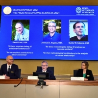 The Nobel Economics Prize was awarded to David Card (left), Joshua Angrist (center) and Guido Imbens (right) for their work based on 'natural experiments.' | REUTERS