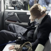 Kozo Iizuka, convicted over a high-profile car accident in Tokyo in 2019, leaves his home in the capital on Tuesday to go through imprisonment procedures. | KYODO