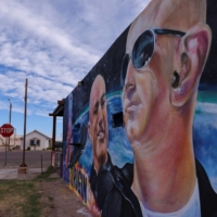A mural of billionaire Jeff Bezos and his space company Blue Origin adorns the side of an empty building a day before his company will send 'Star Trek' actor William Shatner into space from the company's facilities in Van Horn, Texas.  | REUTERS