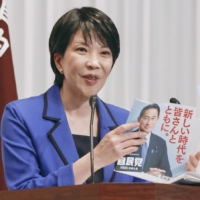 Sanae Takaichi, chair of the Liberal Democratic Party's Policy Research Council, announces the party's manifesto at its headquarters in Tokyo on Tuesday. | KYODO