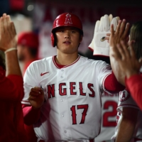 The Los Angeles Angels' Shohei Ohtani is greeted after scoring a run against the Houston Astros at Angel Stadium in Anaheim, California, on Sept. 23.  | USA TODAY / VIA REUTERS