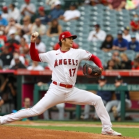 The Los Angeles Angels' Shohei Ohtani throws a pitch against the Seattle Mariners at Angel Stadium in Anaheim, California, on Sep. 26. | USA TODAY / VIA REUTERS