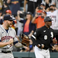 Astros relief pitcher Ryan Pressly celebrates after their win over the White Sox on Tuesday.    USA TODAY / VIA REUTERS