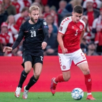 Denmark defender Joakim Maehle (right) and Austria midfielder Konrad Laimer vie for the ball during the World Cup 2022 qualification Group F  soccer match in Copenhagen on Tuesday 2021. | RITZAU SCANPIX / VIA AFP-JIJI