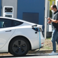 Some cities don't have enough charging plugs for electric cars that rely on street parking.   REUTERS