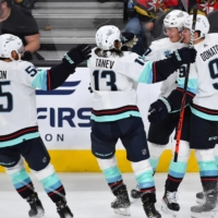 Kraken players celebrate Morgan Geekie's goal against the Golden Knights on Tuesday in Las Vegas. | USA TODAY / VIA REUTERS