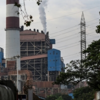 Emissions rise from a chimney at a thermal power station in Mumbai. | BLOOMBERG
