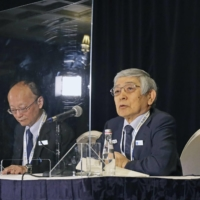 Bank of Japan Gov. Haruhiko Kuroda speaks at a news conference after the Group of 20 meeting of finance ministers and central bankers in Washington. | KYODO