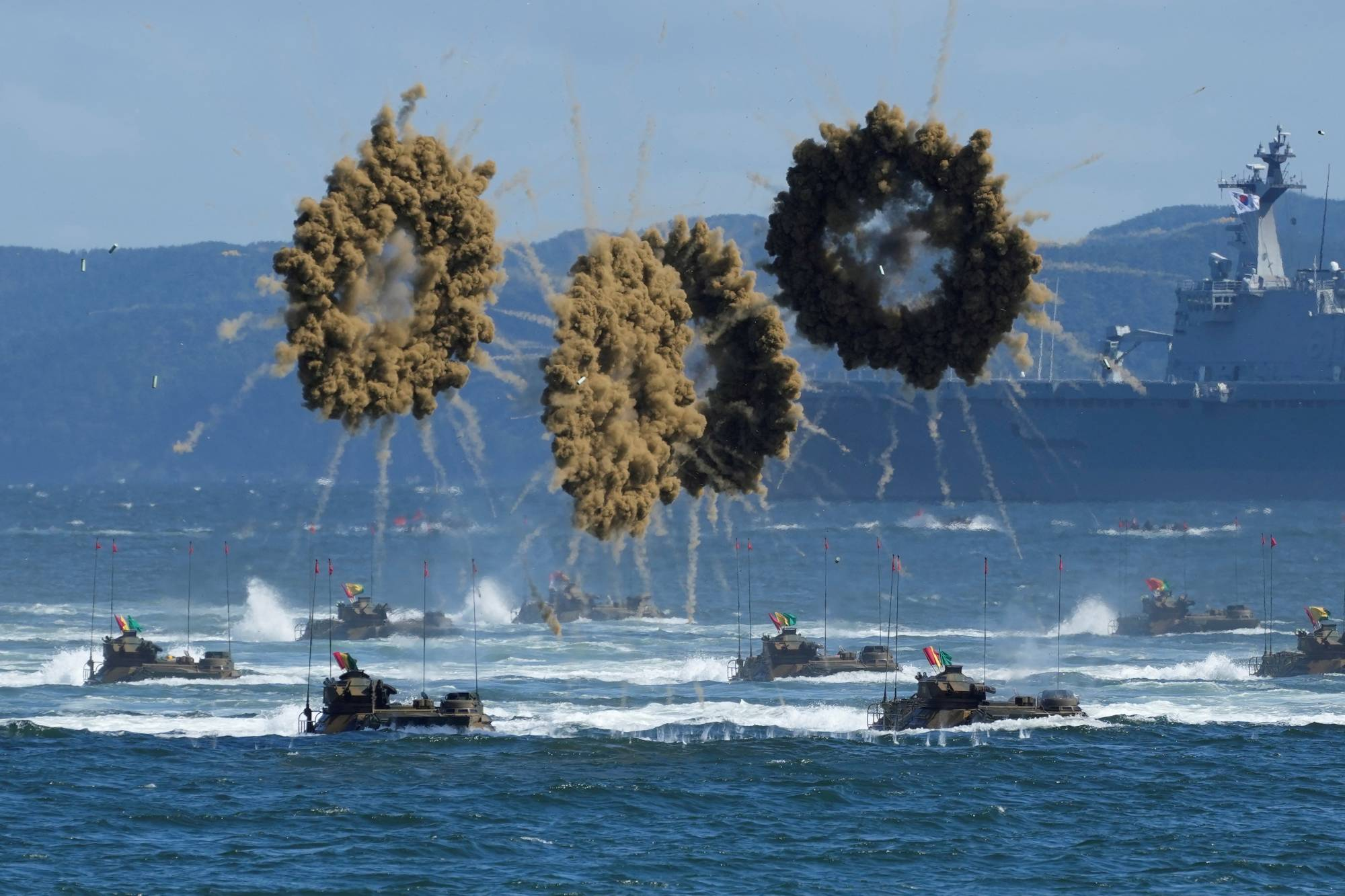 South Korean amphibious assault vehicles sail to shore amid a smokescreen during a media event on Sept. 31, a day ahead of the 73rd anniversary of the country's Armed Forces Day, in Pohang, South Korea.   POOL / VIA REUTERS