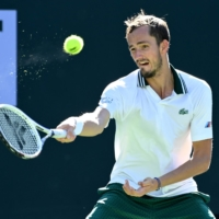 Daniil Medvedev hits a return against Grigor Dimitrov during their fourth-round match at the BNP Paribas Open in Indian Wells, California, on Wednesday. | USA TODAY / VIA REUTERS