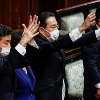 Prime Minister Fumio Kishida and his Cabinet ministers shout banzai cheers after the dissolution of the Lower House was announced at the Diet in Tokyo on Thursday. | REUTERS