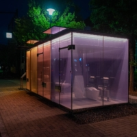 """The restrooms, designed by architect Shigeru Ban, feature an opacity-changing """"smart glass."""""""