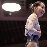 Hitomi Hatakeda, seen during qualification for the women's team event at the  Artistic Gymnastics World Championships in Kitakyushu, Fukuoka Prefecture, on Monday, injured her spine while training on the uneven bars on Wednesday.